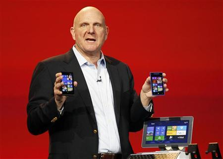 Microsoft CEO Steve Ballmer displays Windows Phone 8 devices at the Qualcomm pre-show keynote at the CES in Las Vegas